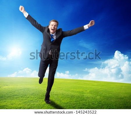 happy business man running on spring field - stock photo