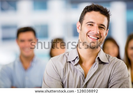 Happy business man with a group at the office - stock photo