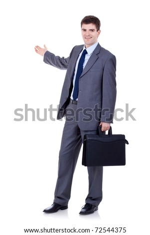 Happy business man with briefcase presenting and showing with copy space for your text isolated on white background