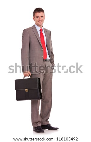 Happy business man with briefcase standing on white background - stock photo