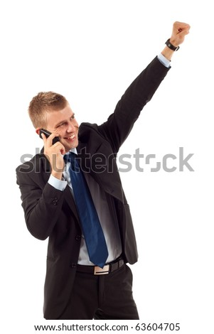 happy business man with cellular phone winning over white