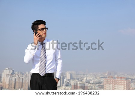 Happy business men call by smart phone on business architecture background - stock photo