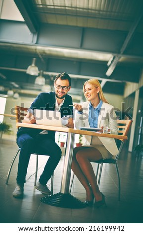 Happy business partners discussing computer data or project - stock photo