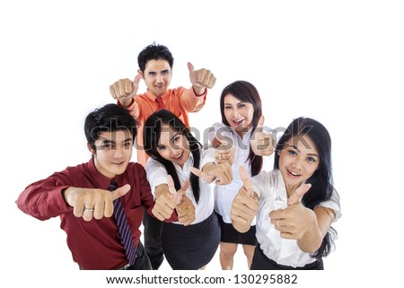 Happy business people giving thumbs up on white background - stock photo