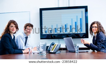 Happy business people having meeting at modern office, smiling. - stock photo