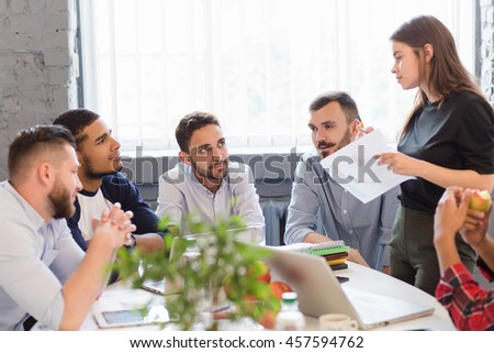 Happy business people listening to performer woman in front of them. Businessmen thinking about new companies, enterprises and firms to be established. - stock photo
