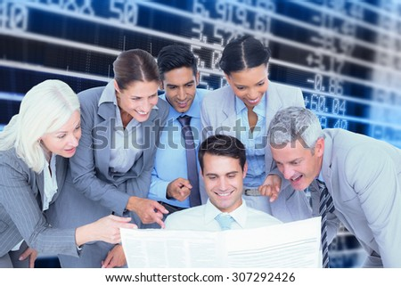 happy business people looking at newspaper against stocks and shares