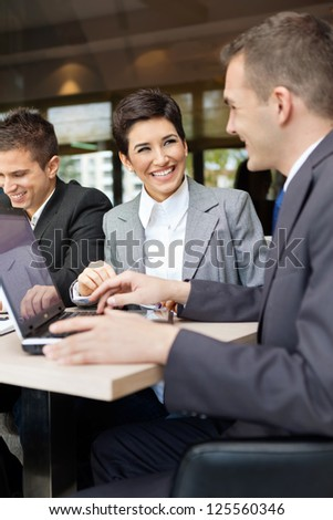 Happy business people on meeting - stock photo