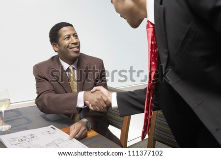 Happy business people shaking hands at office - stock photo