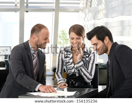 Happy business people working in team at office. - stock photo