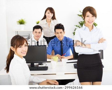 happy business people working in the office - stock photo
