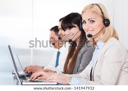 Happy Business People Working On Laptop In Office - stock photo