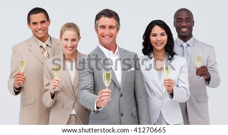 Happy business team celebrating a success with champagne - stock photo