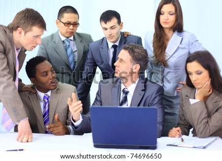 Happy business team having fun while working on a laptop - stock photo