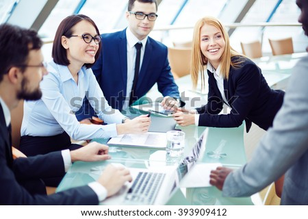 Happy business team planning work together at the table - stock photo