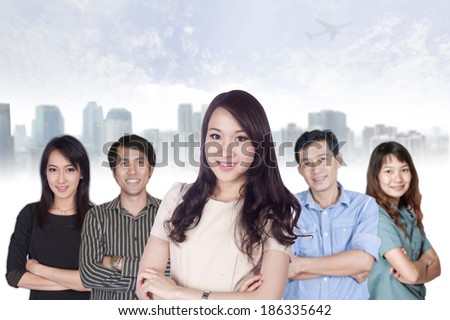 Happy business team with arms crossed at the office  - stock photo