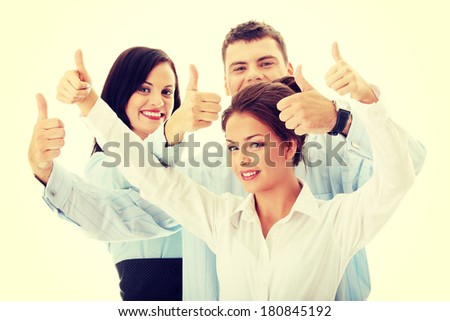 Happy business team with thumbs up - stock photo