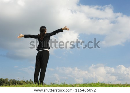 Happy business woman and blue sky - stock photo