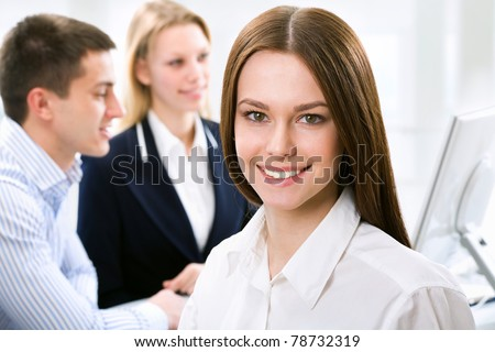 Happy business woman and his pretty colleagues - stock photo