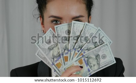Happy Business Woman Displaying a Spread of Cash. Successfuly girl wins bucks in lottery. Concept of money health, abundance, new idea, successful. Close-up