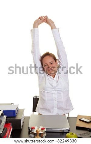 Happy business woman doing some back exercises at work - stock photo