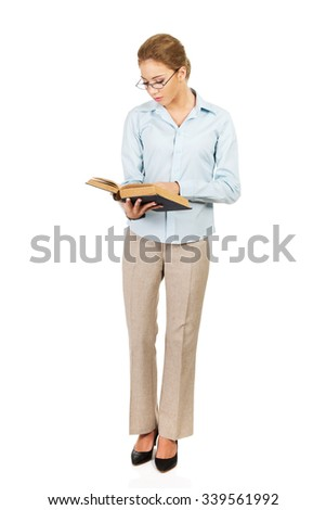 Happy business woman holding a book. - stock photo