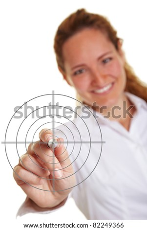 Happy business woman holding a pen to crosshair - stock photo