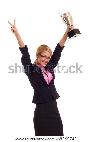 Happy business woman holding a trophy and making a victory gesture