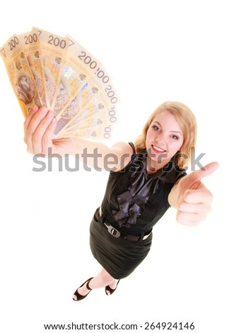 Happy business woman holding polish currency money banknote giving thumb up hand sign gesture. Finance and success. - stock photo
