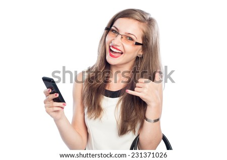 Happy business woman holding smartphone and showing call me sign while smiling isolated on white background - stock photo