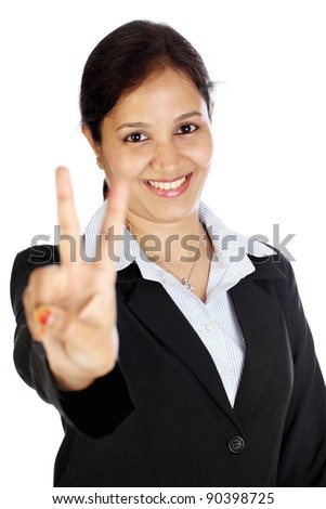 Happy business woman making the victory sign - stock photo