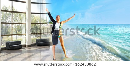Happy business woman on the beach. Vacation.
