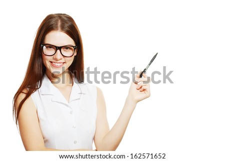 Happy business woman or student pointing towards copy space - stock photo