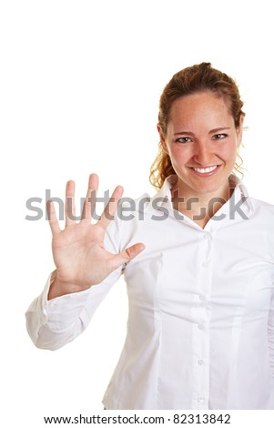 Happy business woman showing five fingers of one hand - stock photo