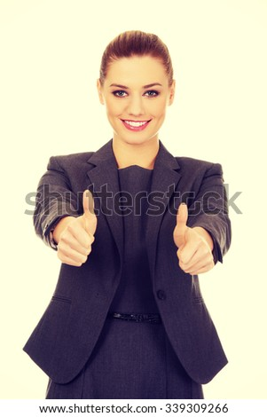 Happy business woman showing thumbs up. - stock photo