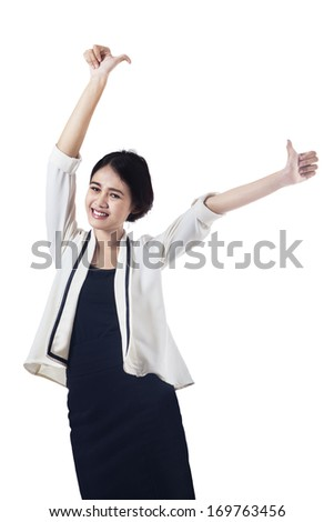 Happy business woman showing thumbs up. isolated on white background