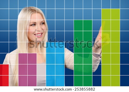 Happy business woman shows a graphic in the web - stock photo