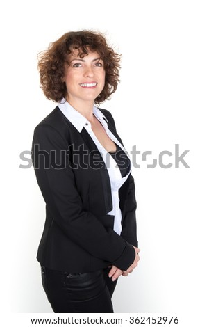 Happy business woman standing smiling to the camera - stock photo
