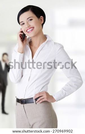 Happy business woman talking on the phone. - stock photo
