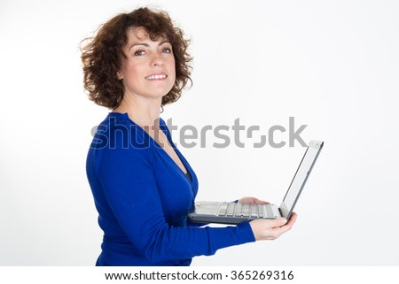 Happy business woman using a laptop - isolated over white background