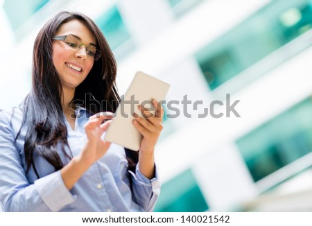 Happy business woman using a tablet computer - stock photo