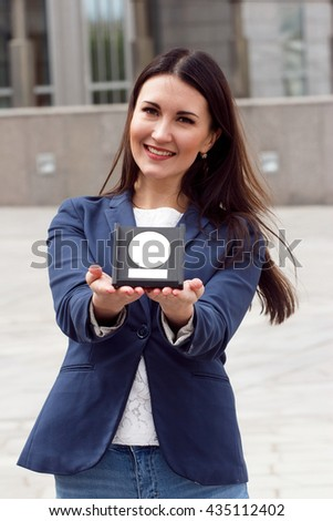 Happy Business woman with award on urban background