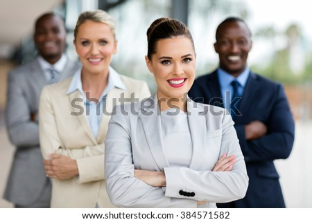 happy business woman with group of businesspeople on background - stock photo