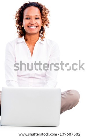 Happy business woman working on a laptop - isolated over white background - stock photo