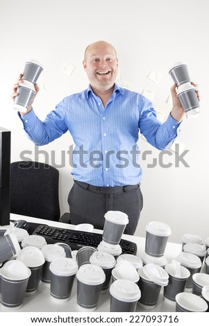 Happy businessman addicted to coffee - stock photo