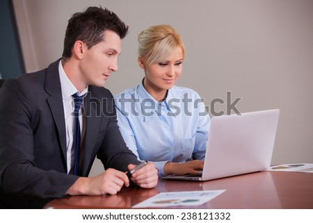 Happy Businessman And Businesswoman Meeting in Modern Office