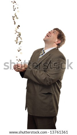 happy businessman catching falling money coins - stock photo