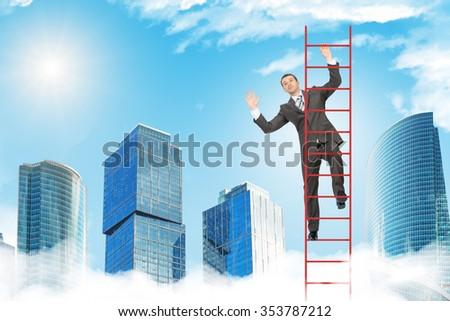 Happy businessman climbing ladder on blue sky background - stock photo