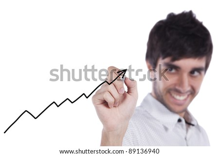 Happy businessman drawing a growth chart on the whiteboard (selective focus) - stock photo