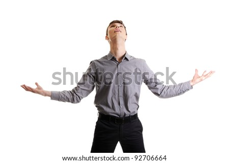 Happy businessman expressing success and victory concept - stock photo